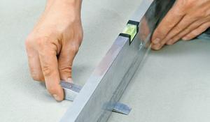 Шаг I - Выравнивание поверхности перед укладкой плитки
